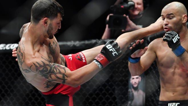 Apr 22, 2017; Nashville, TN, USA; Cub Swanson (red gloves) fights Artem Lobov (blue gloves) during UFC Fight Night at Bridgestone Arena. Mandatory Credit: Christopher Hanewinckel-USA TODAY Sports