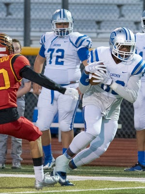 Carlsbad's Zack Sing advances his catch past Hawks Noah Gallardo Friday night at the Field of Dreams in Las Cruces on Sept. 29.
