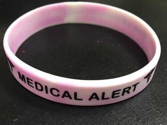 "Affordable rubber bracelets say ""Medical Alert"" on one side and ""Epilepsy/Seizures"" on the other."
