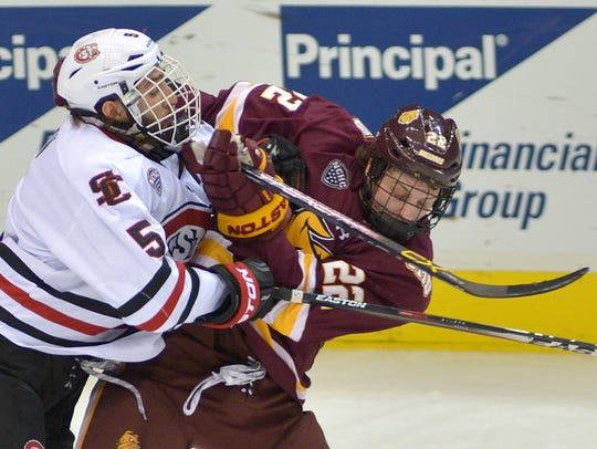St. Cloud State's Nathan Widman (5) and University