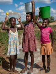 These Zimbabwean girls haul water from distant water