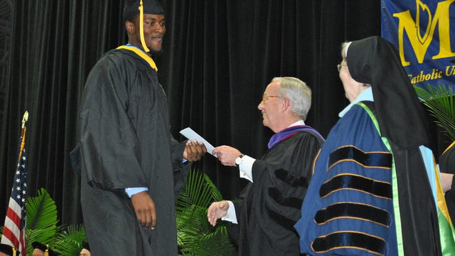 Donald Owens of Detroit received his bachelor's degree in criminal justice. He is the first graduate of Madonna's Bridging Lost Gaps program.