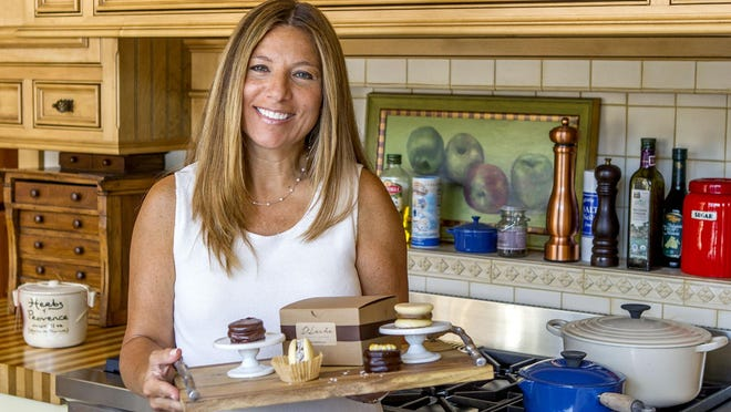 Veronica C. Sain, owner of D'Leche, with a few of her creations at the Creative Kitchens showroom in Red Bank.
