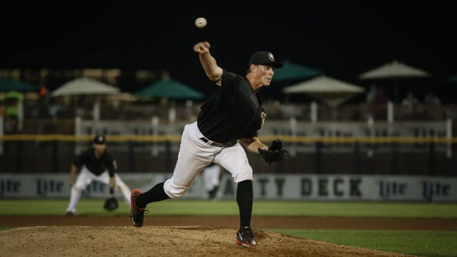 Andrew Thome throws a pitch in his first appearance for the Quad Cities River Bandits in relief Friday in Davenport, Iowa. Thome gave up three hits and an earned run with two strikeouts and a walk in four innings in his Midwest League debut.