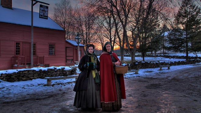 Yuletide in the Country tour guides at the 1808 Thomson's Tavern and Store at Genesee Country Village & Museum.