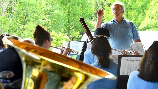 Tom Indiano directs the Webster Village Band at a concert held last summer at the arboretum. (K. Boas)
