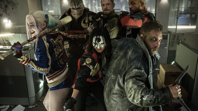 "Harley Quinn (Margot Robbie), Killer Croc (Adewale Akinnuoye-Agbaje), Katana (Karen Fukuhara), Rick Flagg (Joel Kinnaman), Deadshot (Will Smith) and Captain Boomerang (Jai Courtney) are ready for action in ""Suicide Squad."""