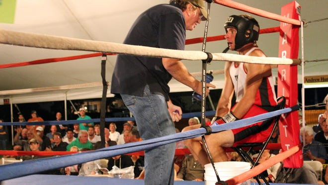 John Russell instructs a young protege, Charlie Muntwyer, in between rounds at a 2012 Marco Island tourney.