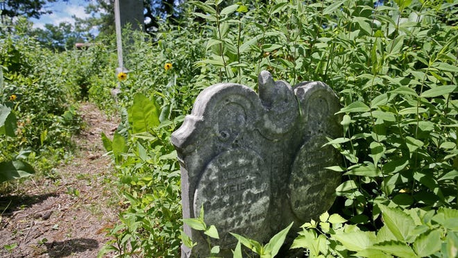 An old weathered headstone in the cemetery.