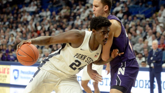 Penn State's Mike Watkins (24) makes a move to the basket against Northwestern's Pete Nance, right, during the second half of an NCAA college basketball game, Saturday, Feb. 15, 2020, in State College, Pa. (AP Photo/Gary M. Baranec)