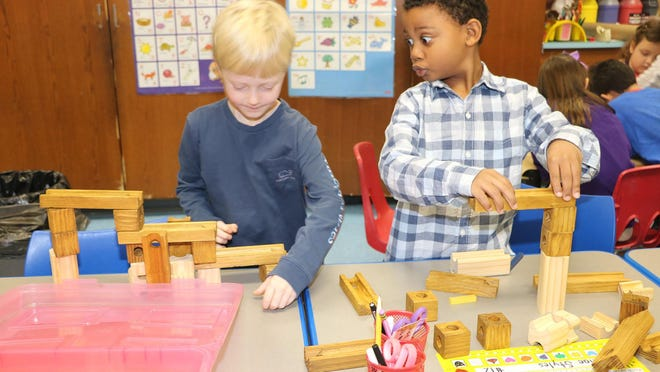 Plattekill Elementary School students Jeffrey Pushman and Alijah Newkirk playing with blocks in one of the play-based learning centers in Barbara Bouck's Grade 1 classroom.