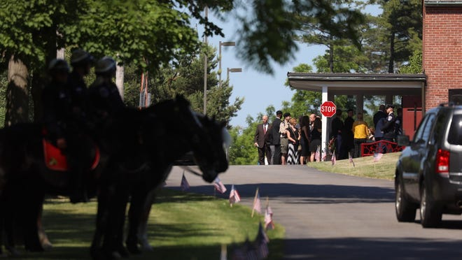 A mounted police unit is present as part of the memorial service Friday for Rochester Police Lt. Aaron Colletti in Brighton.