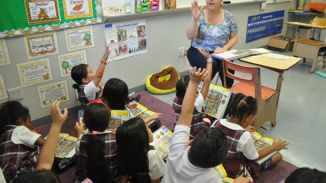 Teacher Karla Sambora with a first-grade class.