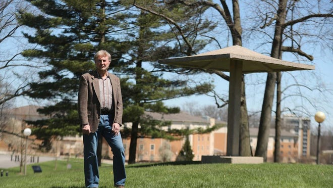 Drew Tiene is a retired professor from Kent State University who produced a 1995 television documentary about the shootings and also served on the committee that established the May 4 Visitors Center on the campus. He is standing near the Pagoda atop Blanket Hill where the Ohio National Guard began shooting at students in the parking lot below on May 4, 1970. Tiene was photographed Monday, April 20, 2020 in Kent, Ohio.