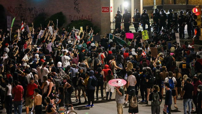Protestors arrive to the Austin Police Department's headquarters from the Texas State Capitol on Sunday. Texas State University student Justin Howell, 20, was critically injured during Sunday's protest, university officials said Wednesday.