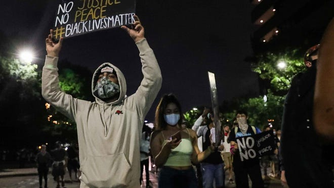 Protesters headed south on Congress Avenue to Austin police headquarters Sunday night. Downtown businesses owners said they're sympathetic to peaceful protests, but some described the demonstrations as a financial blow amid the coronavirus pandemic.