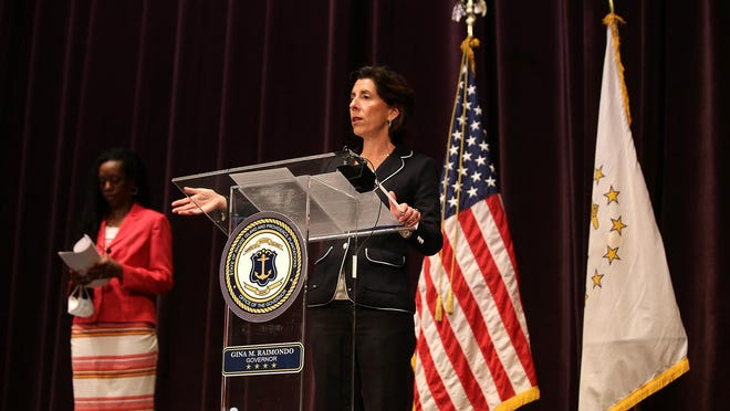 Gov. Gina Raimondo, center, and state Health Director Dr. Nicole Alexander-Scott, left, speak at Wednesday's daily coronavirus briefing. The state reported 21 additional coronavirus-related deaths and 143 new cases of COVID-19 on Wednesday.