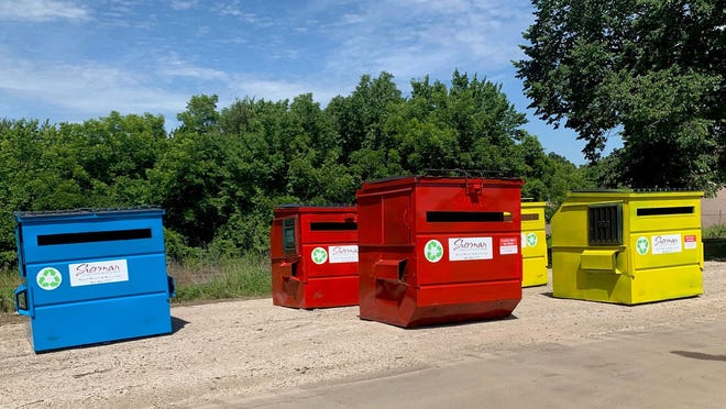 A group of  dumpsters for recyclable materials sit at Sherman's collection site. As the city ends its curbside collections, a outside provider is looking to move into the Sherman market.