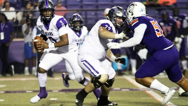 Central Arkansas and former Battle offensive lineman Parker Ray (73) protects Bears' quarterback Breylin Smith (3) during an October 2019 game against Northwestern State.