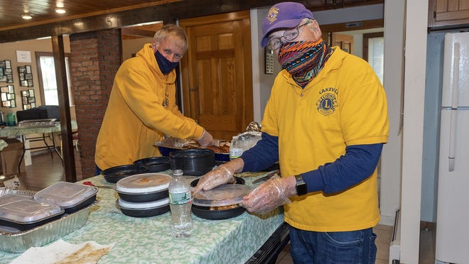 Lions Bob Joyal, left, and Ed Carey volunteered for the Lions Club fundraiser.
