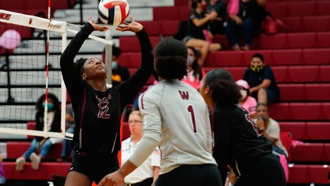 Weiss setter Ashlyn Wilson sets the ball in a match last week against Pflugerville. The Wolves lost in five sets but bounced back to sweep Manor on Friday.