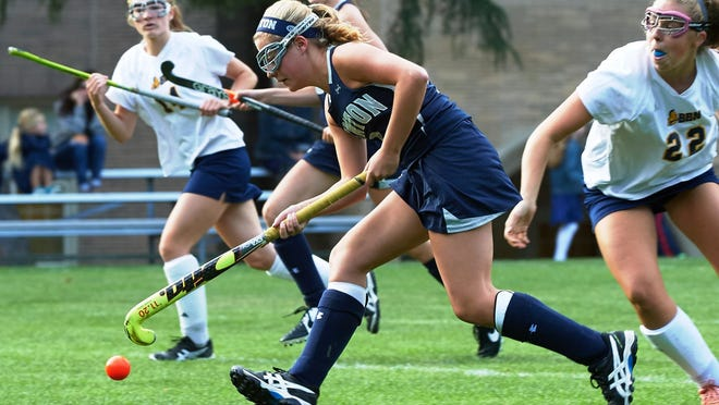 Elizabeth Warner, shown playing field hockey for Newton Country Day School, is currently playing field hockey at Boston College as the Atlantic Coast Conference decided to play the sport this fall amid the COVID-19 pandemic.