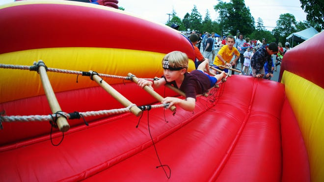 Pictured in this 2017 file photo are children enjoying an inflatable attraction at Norwell Summer Fest.