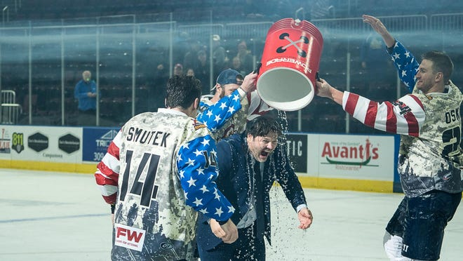 Rivermen veterans Cody Dion and Ben Oskroba dunk head coach Jean-Guy Trudel after a 3-0 win over Macon gave him his Peoria franchise record-setting 234th victory in an SPHL game at Carver Arena on Saturday, Nov. 2, 2019.