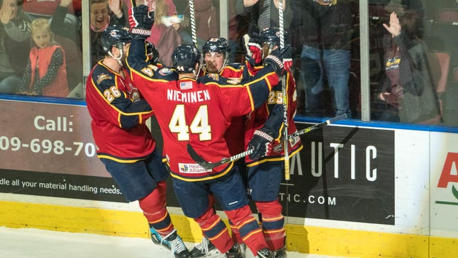 Peoria Rivermen rookie winger Ryan Cusin (against the glass) celebrates his dramatic game-tying goal with 76 seconds left during Peoria's 3-2 sudden-death shootout win over Roanoke at Carver Arena on Sunday, March 8, 2020.