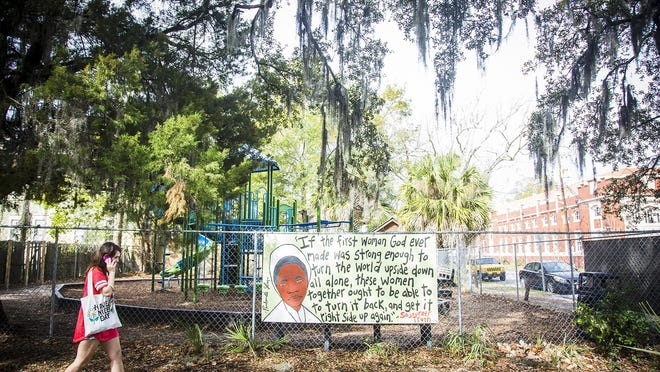 A painting of Sojourner Truth by Panhandle Slim hangs on a now-empty playground. The art inspires young students.