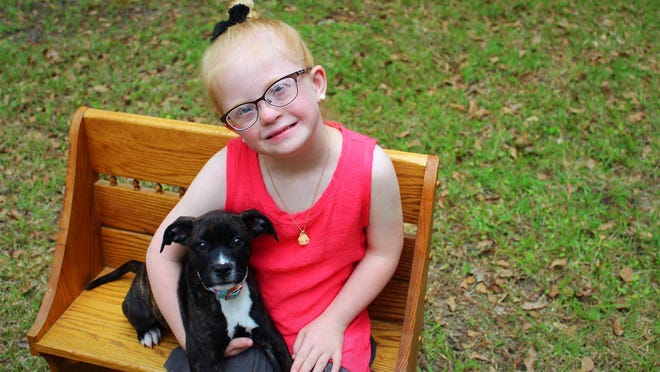 "Paisley Metz, 7, of Rincon, knows how to introduce herself to new people. She'd walk up to you and ask ""What's your dog's name?"" even if no dog is present. She is shown with her dog, whose name is Sadie."