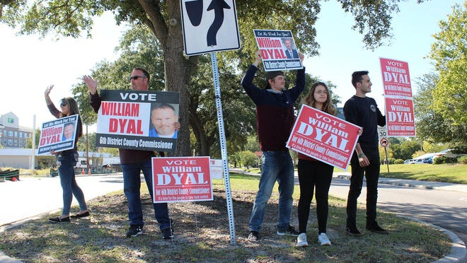 Chatham County Commission's District 6 Republican candidate William Dyal, second from left, was joined by his wife Kristy with other family members and supporters along Abercorn Street on Tuesday.