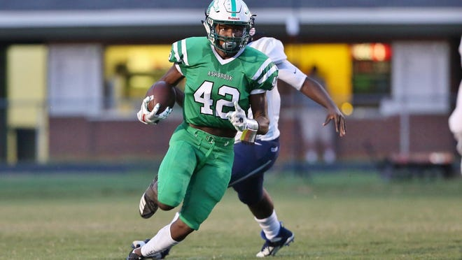 Ashbrook running back Kendall Massey finds running room in the Clover defense during Saturday's game.