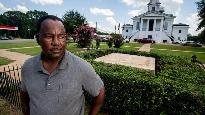 Lowndes County Commissioner Robert Harris stands near the spot where a Confederate monument once stood in front of the county courthouse in Hayneville, Ala., on July 17, 2020.