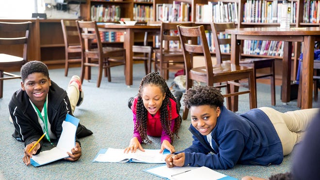 Deep Center program participants at Hubert Middle School, from left, are Javontae Vann, Kayonna Mitchell and Akeyce Johnson  prior to the COVID-19 pandemic.