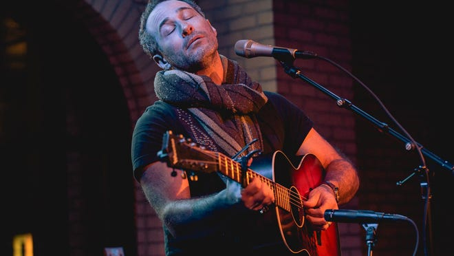 Traverse City musician Joshua Davis plays guitar and is known for indie-folk music.