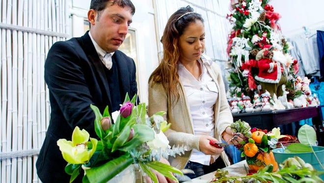Marius and Ilinca Dumitriade prepare flowers in the Ocean Grove Flower and Gift Shop.