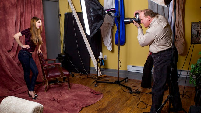 John Pacetti, owner of South Street Photography, does a quick portrait session with his daughter Diana at his studio in Freehold Township. He is a veteran photographer specializing in portraits, photo restoration work and especially weddings.