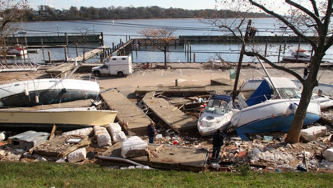 Boats and other debris washed ashore at the Perth Amboy Harborside Marina following Superstorm Sandy.