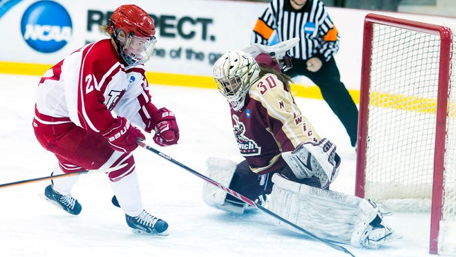 Norwich goaltender Laurie King, right, prepares for a shot attempt from Plattsburgh's Giovanna Senese during Friday's NCAA Division III women's hockey game at the Ronald B. Stafford Arena in Plattsburgh, N.Y.