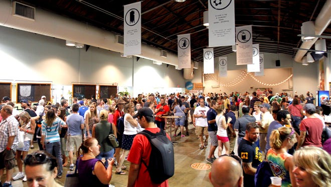The Indiana Beer and Wine Exhibition at the Indiana State Fair in Indianapolis on Saturday, Aug. 9, 2014.
