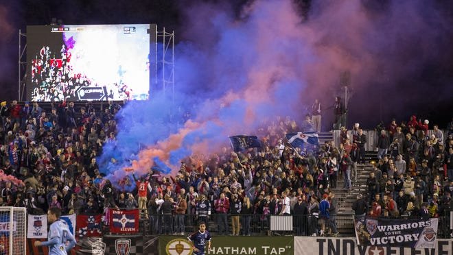 Fans let off colored smoke after an early Indy Eleven score, Minnesota United FC at Carroll Stadium last October.