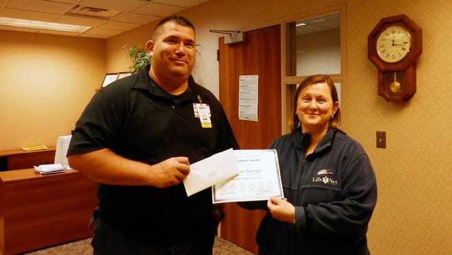 The Nurse Practice Council of Marlette Regional Hospital awarded a $500 scholarship to employee George Nelson, EMT. Susan Brzezinski, chair of the Marlette Regional Hospital Nurse Practice Council, awards Nelson with a check for $500 and a certificate.