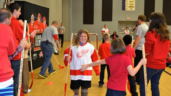 Landmark Academy in Kimball Township welcomed the Detroit Red Wings Foundation at a special interactive assembly focusing on dedication and education, healthy living and acceptance of differences. Fifth grader Lacey Hunt, decked out in Red Wings attire, celebrates after participating in the hockey shootout between the teachers and the students.