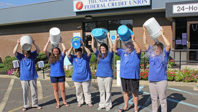 """Thunderbolt Area Federal Credit Union staff members in Millville accepted the """"ALS Ice Bucket Challenge"""" from Jersey Shore Federal Credit Union in Northfield on Aug. 25, and sent out a challenge to Verna's Flight Line Restaurant at Millville Airport. President and CEO Bob Millard also challenged all members of Thunderbolt Area Federal Credit Union to take the challenge or donate or both. (From left) Sandy Blanck, Brooke Thompson, Cindy Rascone, Amanda Ayars, Bob Millard and Donna Millard take the challenge."""