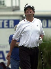 Bruce Lietzke reacts to missing a putt during the 2003