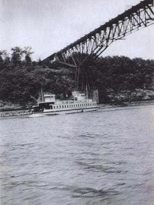 A ferry on the Hudson River heads toward the terminal on the Highland side with the Poughkeepsie Railroad Bridge in the background.