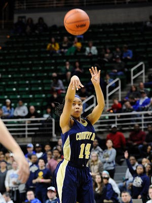 Detroit Country Day's Kaela Webb (14) puts up a three-point shot in the first half. She finished with 20 points as Detroit Country Day defeated Haslett, 49-41, to win the state Class B title Saturday at the Breslin Center.