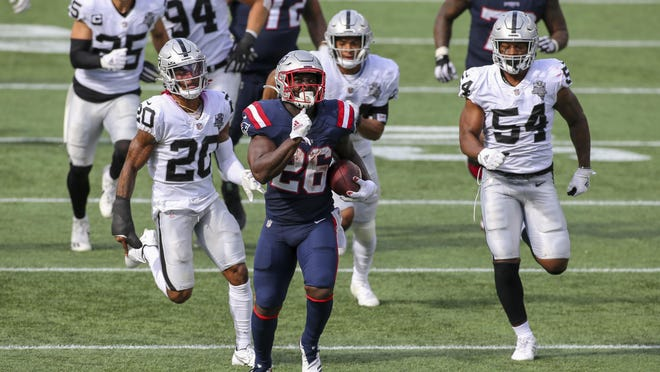 New England Patriots running back Sony Michel (26) is chased by Las Vegas Raiders defensive back Damon Arnette (20) and linebacker Raekwon McMillan (54) during the second half of an NFL football game, Sunday, Sept. 27, 2020, in Foxborough, Mass.