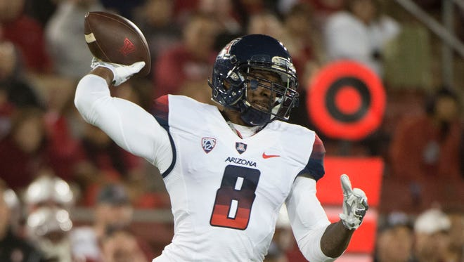 Arizona Wildcats quarterback Jerrard Randall (8) passes the football against the Stanford Cardinal during the first quarter at Stanford Stadium.
